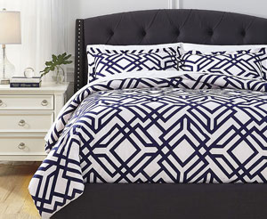 ABF Signature Design by Ashley  Sheets & Top of Bed
